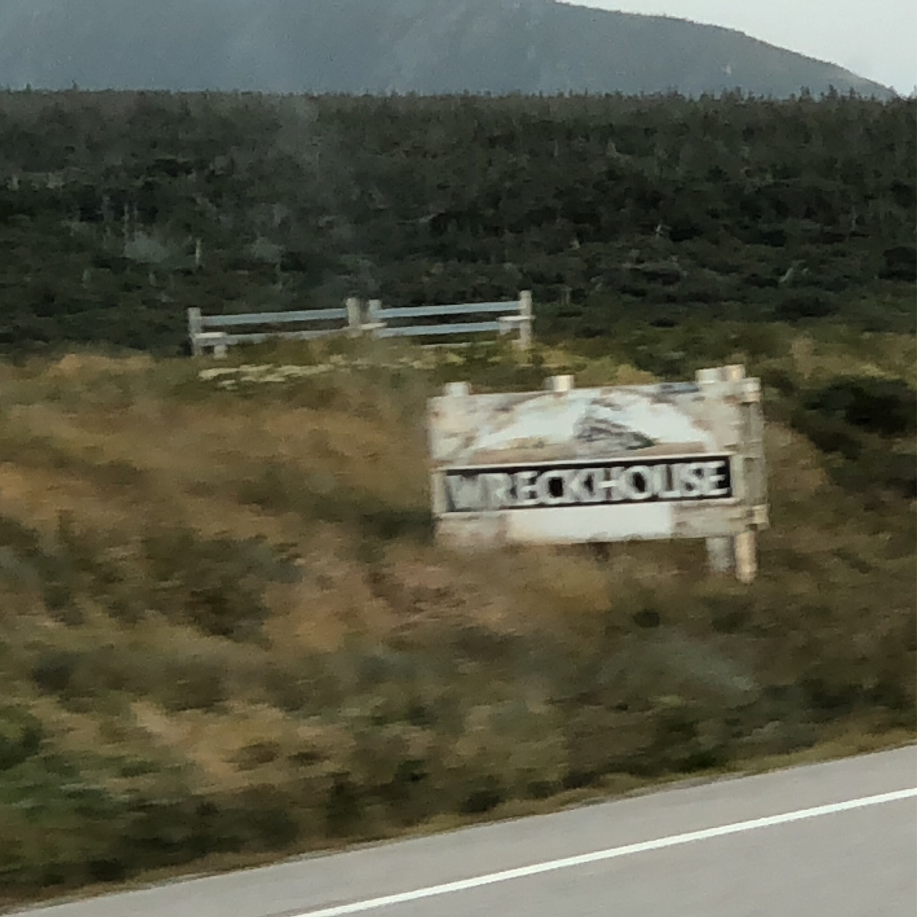 wreckhouse sign in front of mountains