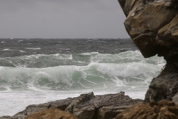 waves framed by a rock