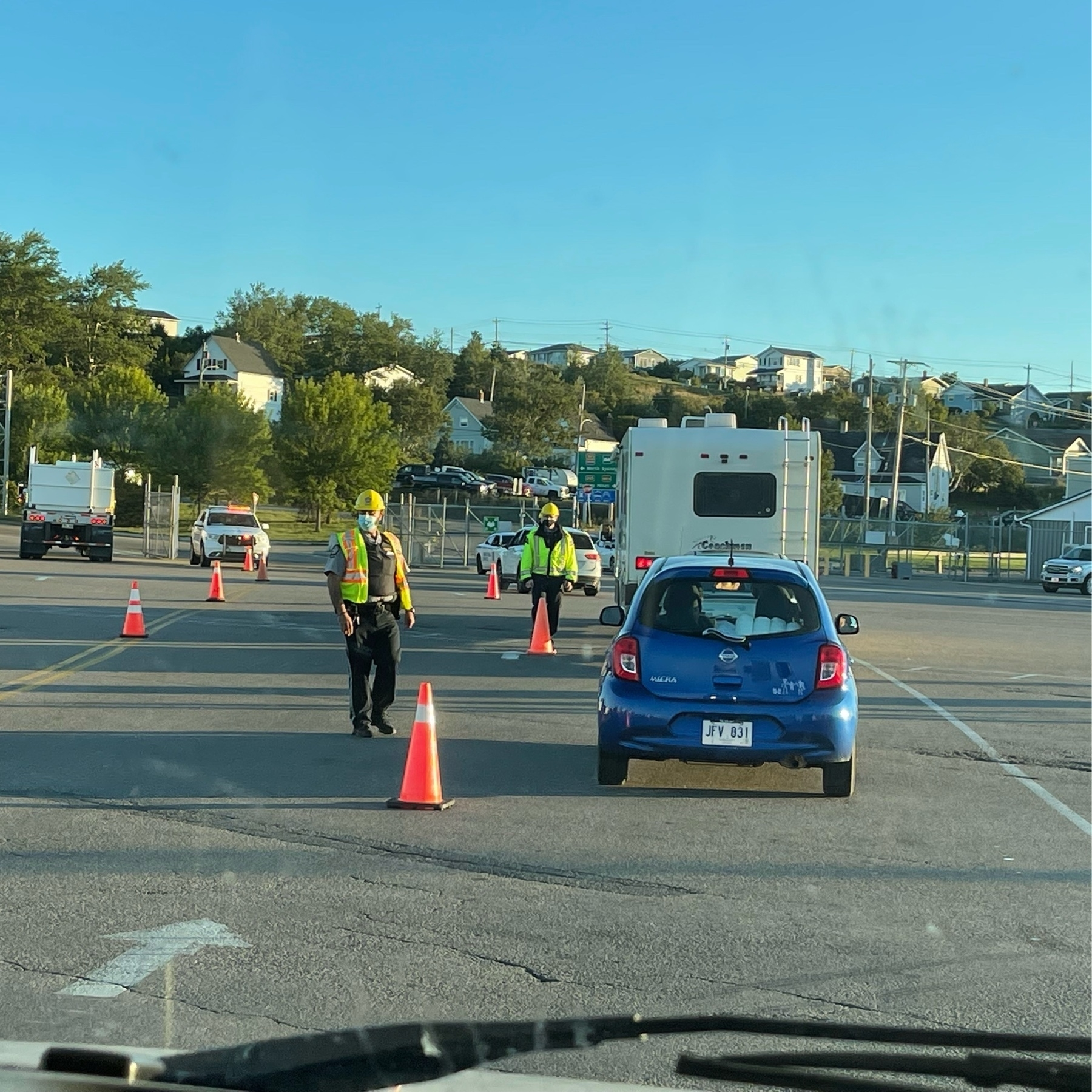 vehicles approaching two men in safety vests