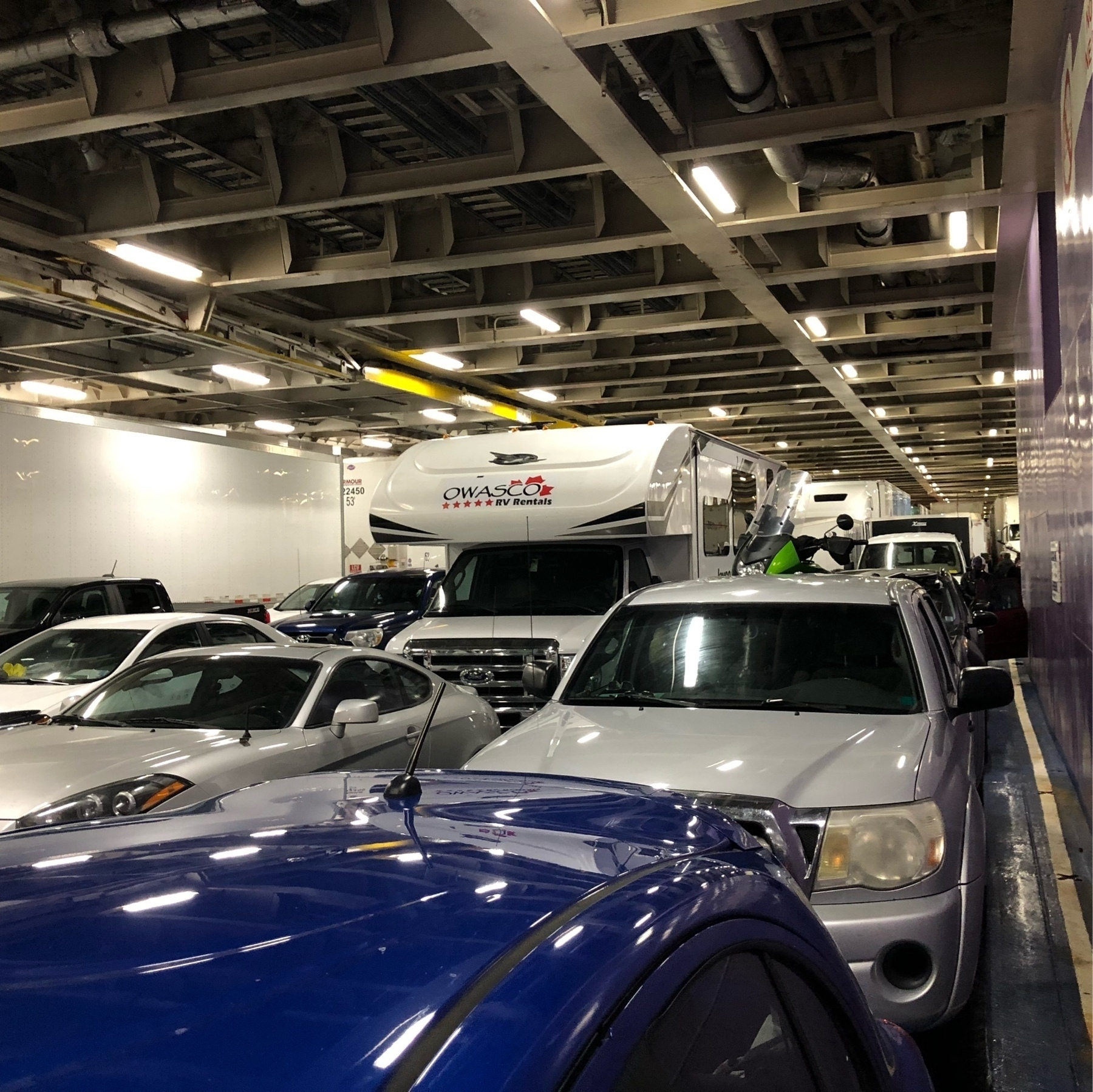 vehicles parked closely inside a ferry